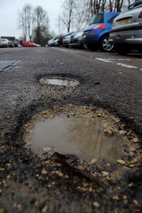 Massive potholes in Cirencester's Beeche