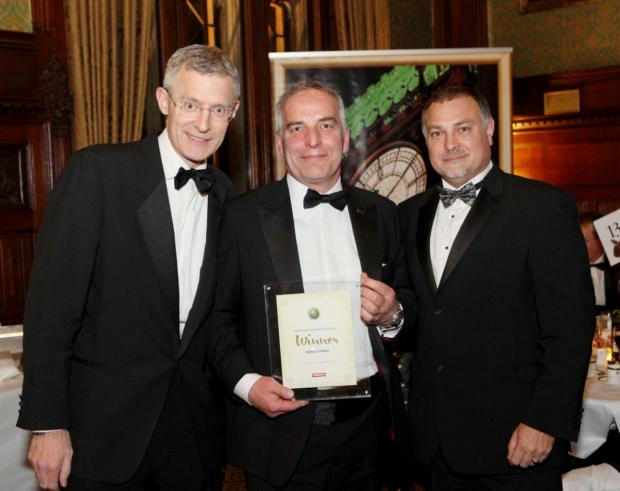David Ball (centre) given award by TV presenter Jeremy Vine and Nick Rainsley