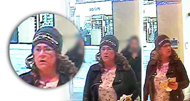 Police release CCTV image of woman wanted in connection with stolen credit card use