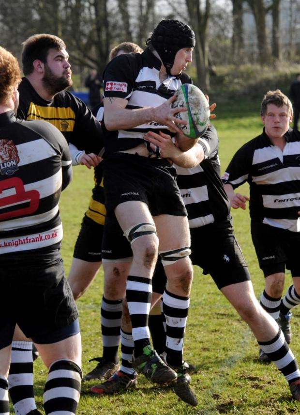 Wilts and Gloucestershire Standard: Chris Powesland in the thick of the action for Stow (black and white) against Wallingford game