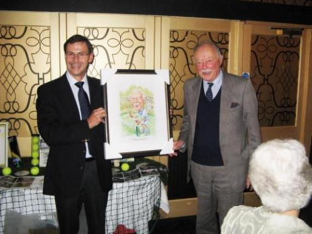 Peter Hartland (right) and former chairman of Ashton Keynes Tennis Club Paul Prior celebrate 25 years of the club in November 2012