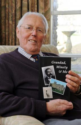 Robin Walker with his book of family memories