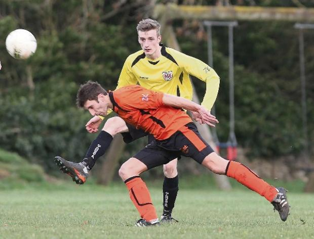 Lee Keveren, of Didmarton (yellow) who opened the scoring for his side on Saturday