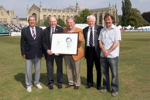 Tom Graveney, second from left, receiving a Jack Russell painting at a recent Cheltenham Festival