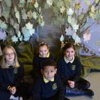 Wilts and Gloucestershire Standard: Ann Edwards C of E Primary School pupils create tree in teachers memory