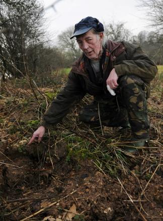 Animal rights campaigner Mike Haines at the blocked sett in Pinbury Park