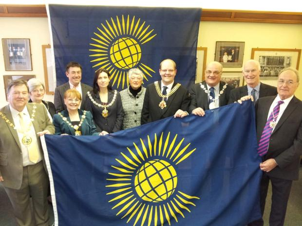 Dame Janet with local mayors and the Commonwealth Flag