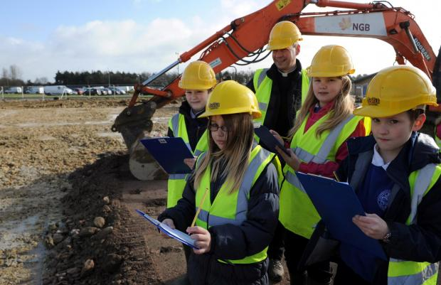 Pupils from Watermoor School get their first look around the site of their new school being built at Kingshill