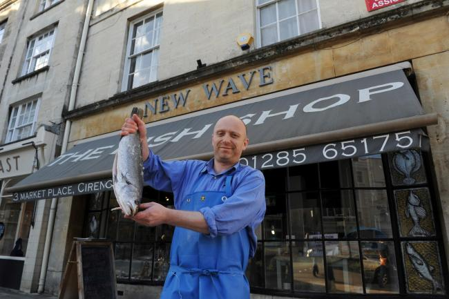 Manager of New Wave Fish Shop in Cirencester Ben Hoggett standing outside the shop's former building in the Market Place. The shop is now based on Dyer Street