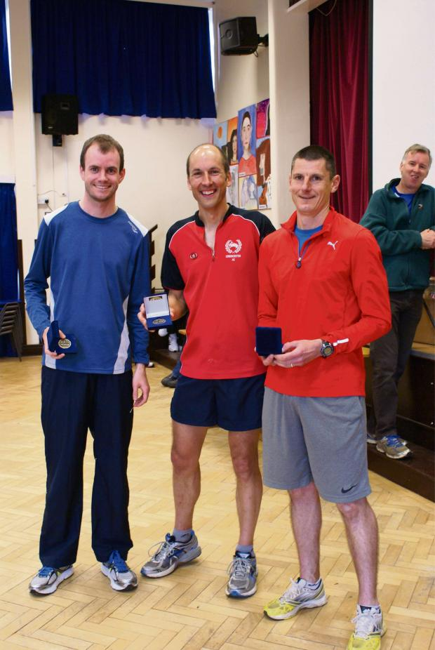 Wilts and Gloucestershire Standard: The winning Cirencester Men's team at the Highworth 5-mile – l-r: Bill Leggate (third), Adrian Williams (winner) and Simon Fortnum (fourth)