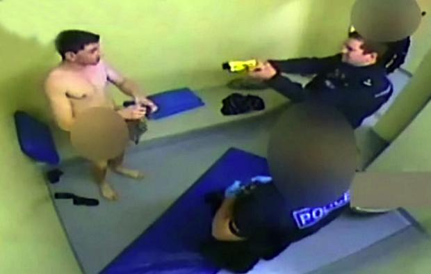 CCTV footage shows police officer tasering man in cell
