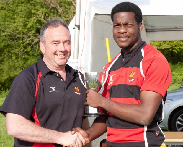 Wilts and Gloucestershire Standard: Rob Lister presents the U18s trophy to Olo Omotoso of Cirencester RFC