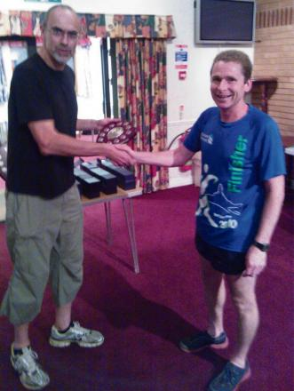 Ewen Smith receiving his Hilly 100 award from Chris Dry