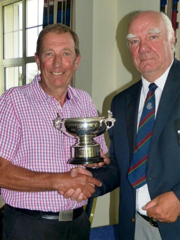 Wilts and Gloucestershire Standard: Chris Watson receives the Eric Cole Bowl from Cirencester Golf Club seniors captain Clive Bennett