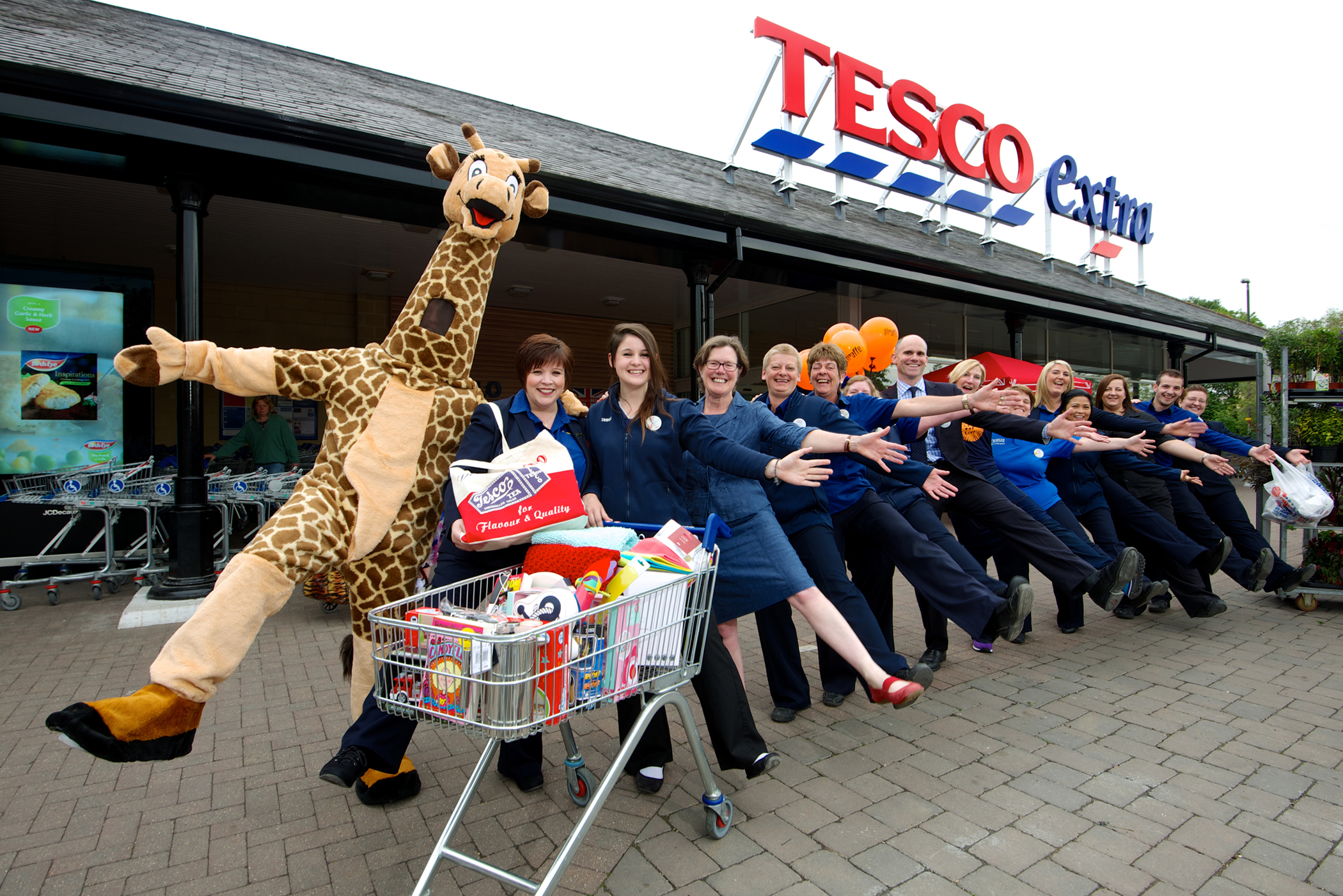 Staff from the store and volunteers from The Churn Project celebrated the re-launch of Tesco Extra last Monday