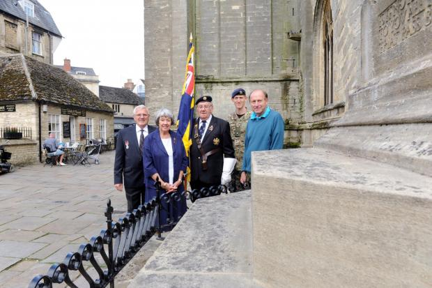 Bill Caldwell, Royal British Legion, Eileen Chapman, Women's Section, Standard bearer Mike Clapton and Major Dave Walker admire the war memorial in the Market Place, Cirencester, carried out by resident Rick Williams