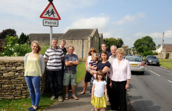 South Cerney residents who are opposed to the conversion of the empty Mitie office building (pictured behind) into a new shop (7176377)