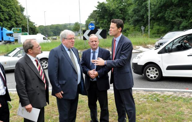 Transport Secretary Patrick McLoughlin, centre, meets with Geoffrey Clifton-Brown MP, Laurence Robertson, MP, and Alex Chalk, Prospective Parliamentary Candidate for Cheltenham, at the Air Balloon roundabout at Birdlip (8309827)