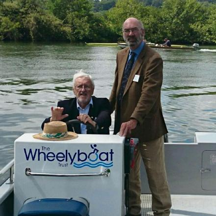 Fishery owner Tim Small (left) with comedian and Wheelyboat Trust patron Bernard Cribbins  (8446981)