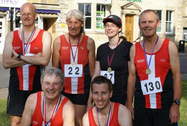Most of the Cirencester AC finishers at the Bourton Mile (l-r): Geoff Wells, Barbara Thomas, Lisa Carpenter, Gordon Jones. Kneeling: Tony Shelbourn, Simon Campbell.