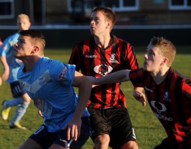 Cirencester Town defender Mark Pritchett, centre, scored against Paulton