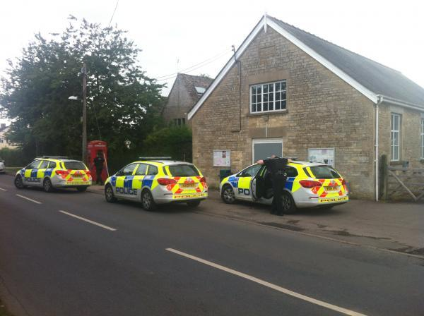Police cars at the scene this evening
