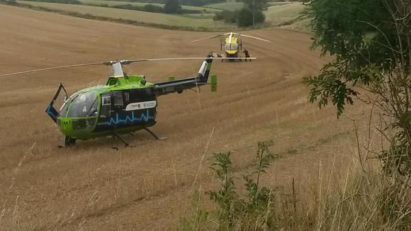 Police helicopter and air ambulance near the scene of the accident