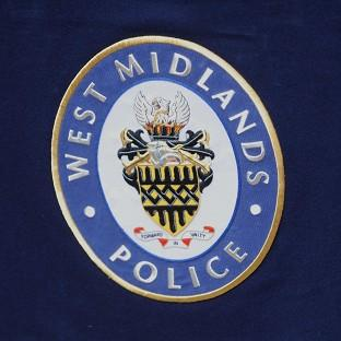 A West Midlands Police officer was hurt during a raid