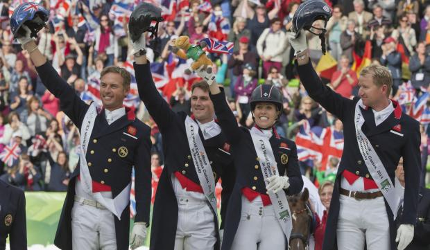 GB silver medallists from left, Carl Hester, Michael Eilberg, Charlotte Dujardin and Gareth Hughes. AP Photo/Michel Euler
