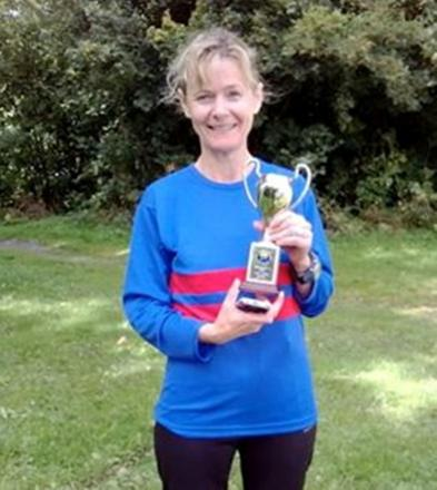 Susan Hunt of Bourton Roadrunners with her trophy at the Headington 5. Picture: Ewen Smith