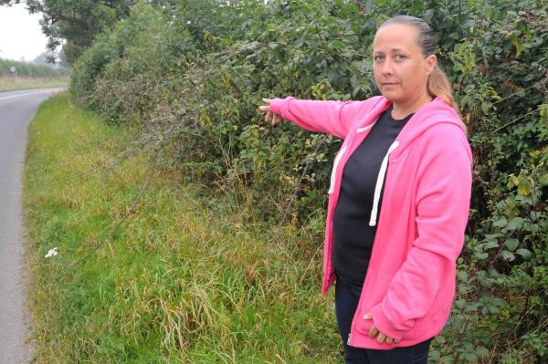 Jessica Mumford at the spot along the A417 where she saw what she believes was a big cat as she was driving back from work