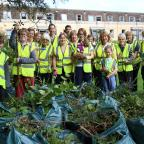 Wilts and Gloucestershire Standard: Members of the Churches Together workforce who planted bulbs and pruned shrubs in the Abbey Grounds in Cirencester (10854573)