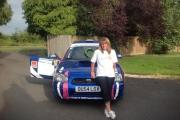 Highworth rally driver Shelly Taunt with her Subaru Impreza, which she hopes to take to the Sol Rally Barbados