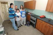 Sereta Hunt and her family in their kitchen, which has been left in a bad state by workers contracted by their housing association Bromford Homes