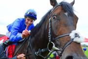 William Buick celebrates winning the 150th Irish Derby on Jack Hobbs. Picture: Pat Healy/PA Wire