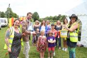 Cirencester Mayor Mark Harris officially opens the Fringe Festival at Cirencester rugby club watched by committee members and family