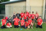 Members of Cirencester Athletics Club with pupils at Paternoster School before their sports day