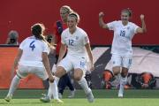 England's Lucy Bronze, No.12, celebrates with team-mates Fara Williams, left, and Jodie Taylor after her goal in the win against host nation Canada at the Women's World Cup. Picture: Adrian Wyld/ Canadian Press via AP