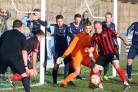 Charlie Griffin finds it hard to get past the St Neots defence