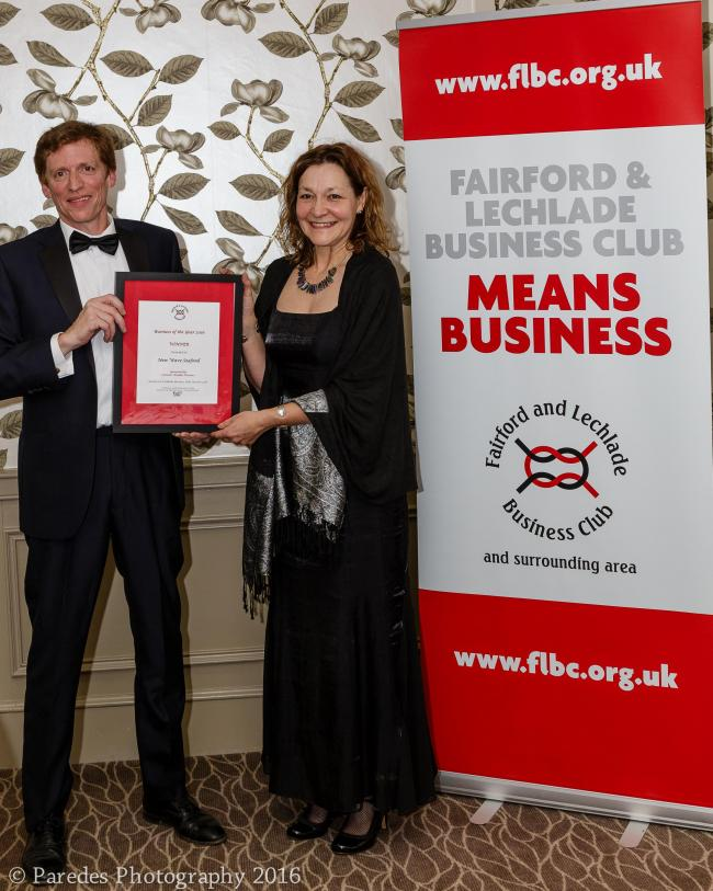 Tim Boyd was presented with the Business of the Year award by Trish Poole
