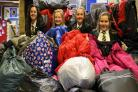 Lillybelle Brown, Freya Partridge, Sadie Walters and Chloe Hand pictured with hundreds of coats to be donated to refugee camps in Syria