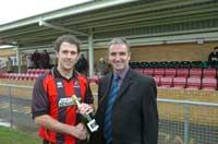 A class act - Lee Molyneaux, left, receives the Standard's Player of the Month award from Cirencester Town chairman, Steve Abbley