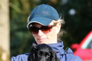 Zara Tindall cradles a spaniel puppy at Gatcombe Horse Trials