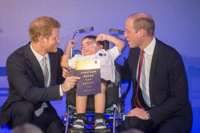The Duke of Cambridge and Prince Harry present the Diana Legacy award to Jonathan Bryan at St James's Palace in London. Photo credit should read: Paul Grover/Daily Telegraph/PA Wire