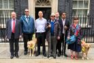 Geoffrey Clifton-Brown and Oliver Stevenson (far left), with others in the blind delegation outside 10 Downing Street. Photo by Sarah Gayton