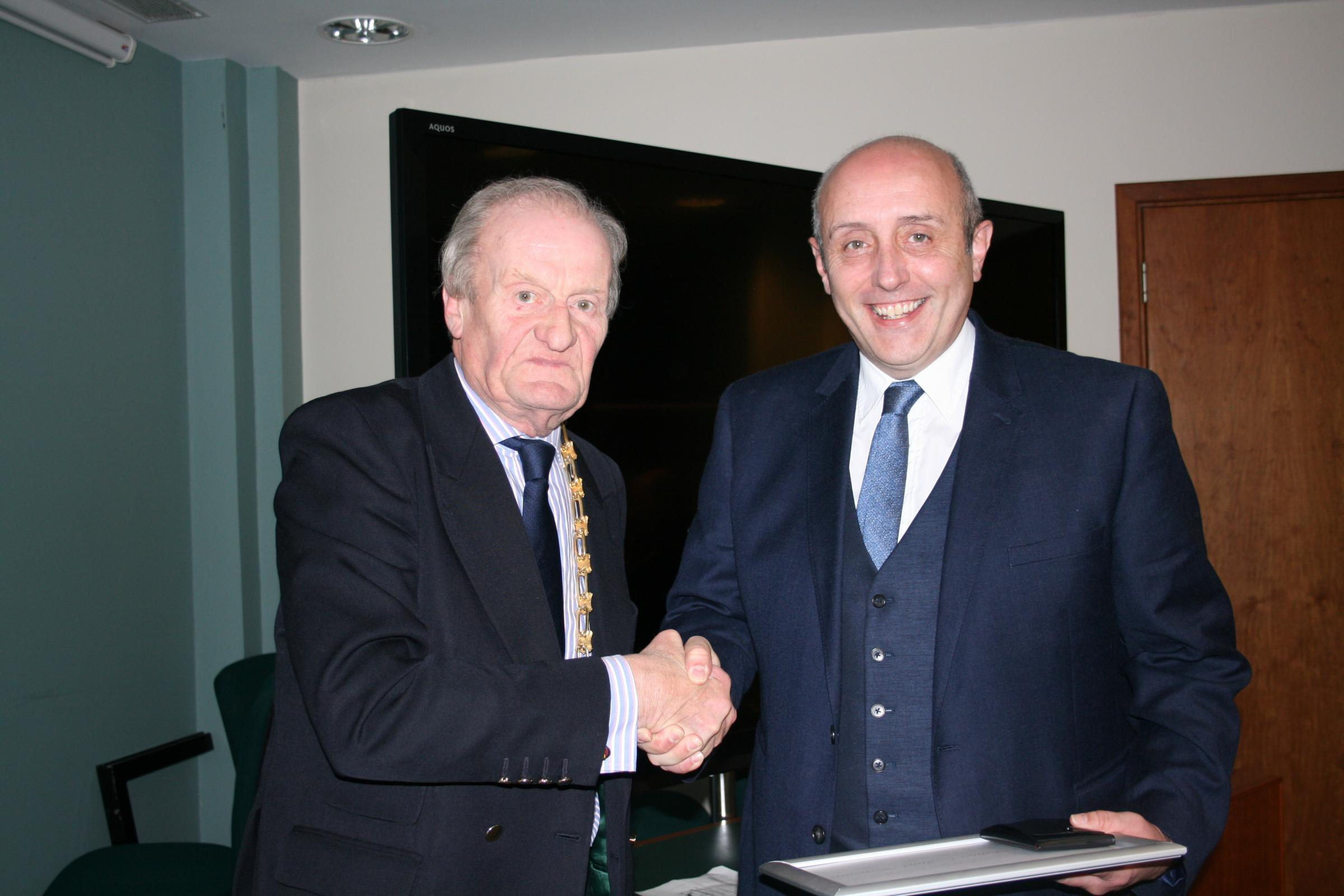 Keith Parsons (right) receives the award from Council chairman Cllr Julian Beale