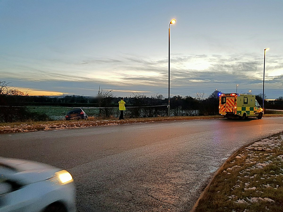 Police and paramedics at the scene of a crash at the Fromebridge Mill roundabout