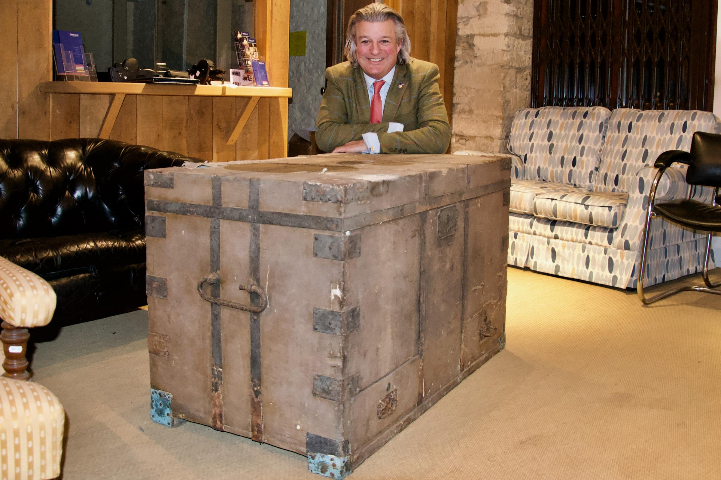 MA Auction Auctioneer Philip Allwood with the Dead Man's Chest