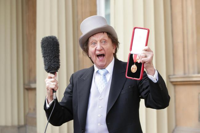 Sir Ken Dodd at Buckingham Palace after he was made a Knight Bachelor of the British Empire (Yui Mok/PA)