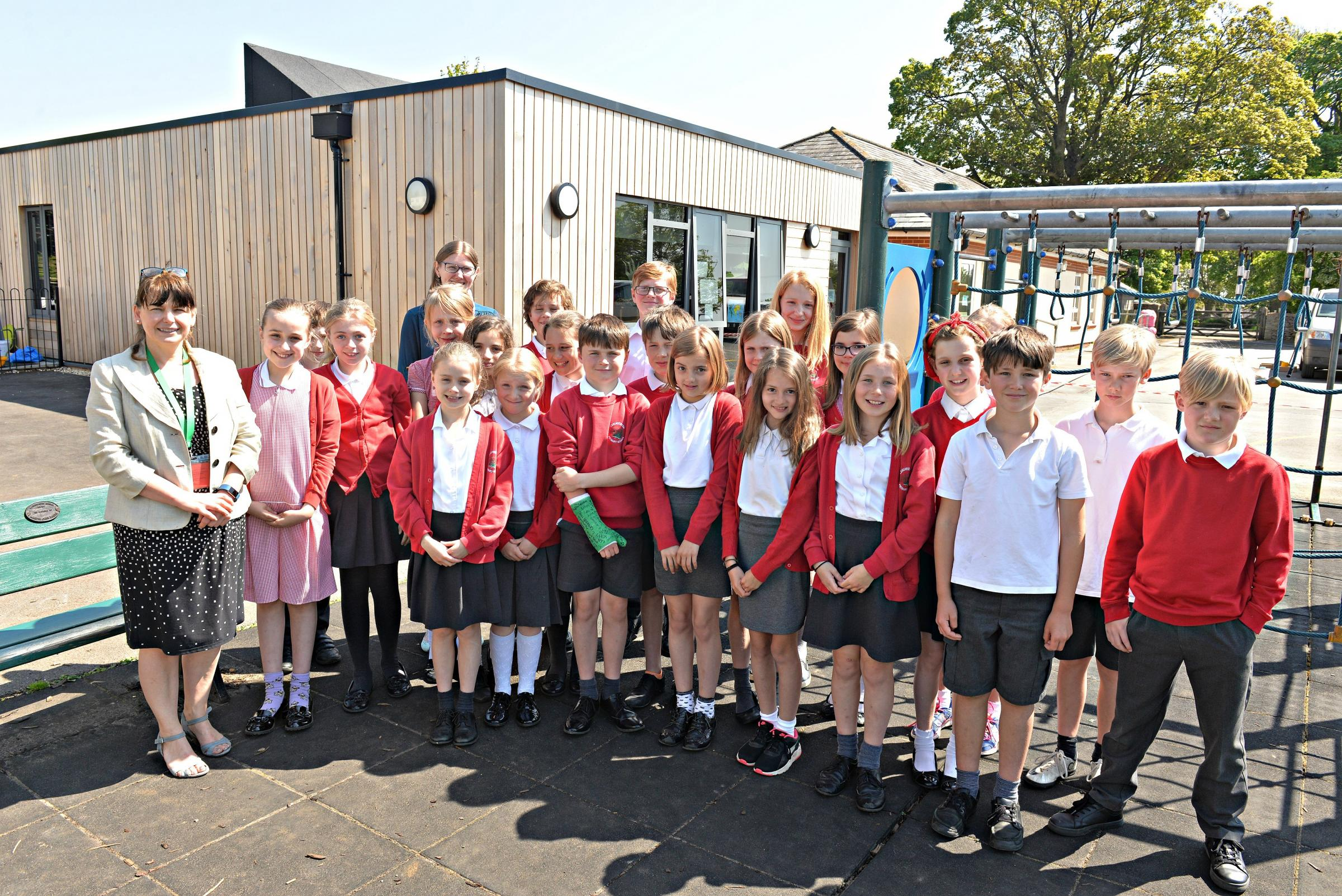 Leighterton Primary School head teacher Meryl Hatfield with Year 5 and 6 pupils happy with their new classrooms.